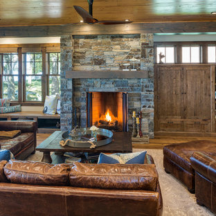 Design ideas for a rustic living room in Minneapolis with white walls, dark hardwood flooring, a standard fireplace, a stone fireplace surround and brown floors.