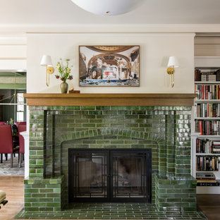 Example of an arts and crafts formal and enclosed medium tone wood floor and brown floor living room design in Los Angeles with beige walls, a tile fireplace, no tv and a standard fireplace