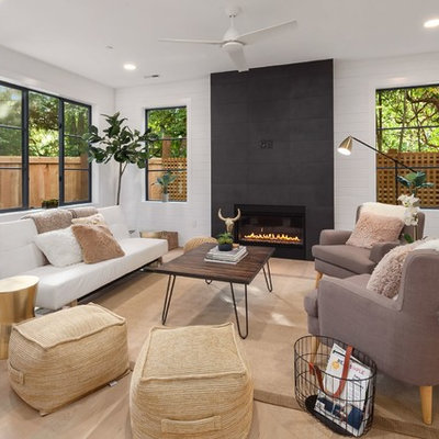 Example of a mid-sized transitional formal and enclosed light wood floor and beige floor living room design in Seattle with white walls, a ribbon fireplace, a tile fireplace and no tv