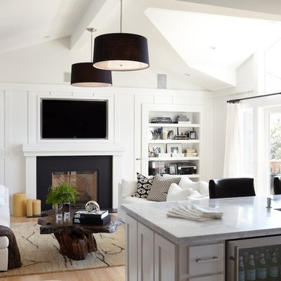 Example of a trendy living room design in San Francisco with white walls, a standard fireplace and a wall-mounted tv