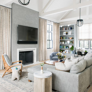 Inspiration for a country light wood floor and beige floor living room remodel in New York with white walls, a standard fireplace and a wall-mounted tv