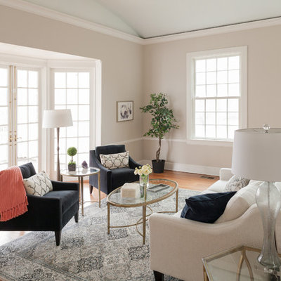 Example of a mid-sized transitional formal and enclosed light wood floor living room design in Bridgeport with white walls