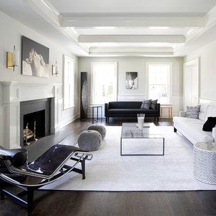 Immagine di un soggiorno classico con sala formale, pareti bianche, parquet scuro, camino classico e nessuna TV