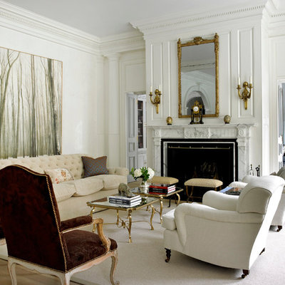 Example of a classic formal and enclosed living room design in New York with beige walls and a standard fireplace