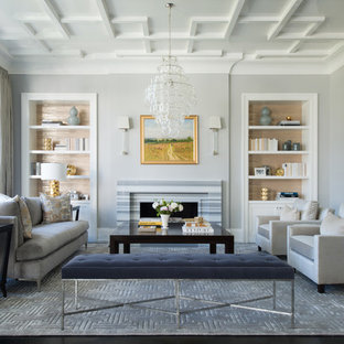 Inspiration for a mid-sized transitional formal and open concept dark wood floor and brown floor living room remodel in New York with gray walls, a standard fireplace, a tile fireplace and no tv