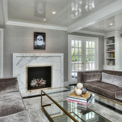 Inspiration for a large transitional enclosed dark wood floor and black floor living room remodel in New York with gray walls, a standard fireplace, a stone fireplace and no tv