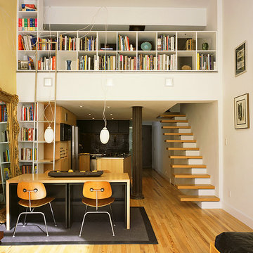 greenwich village loft with custom bookcases and library ladder