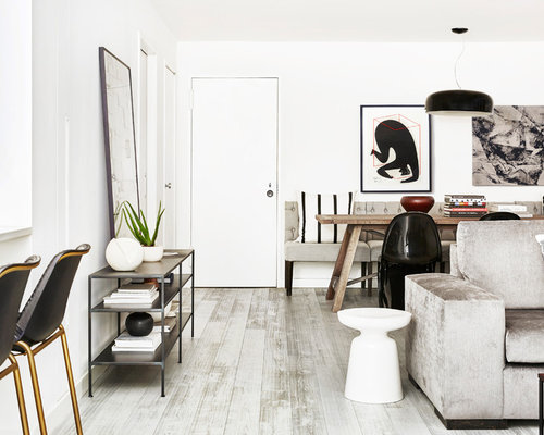 Mid Sized Trendy Loft Style Light Wood Floor And Gray Living Room Photo