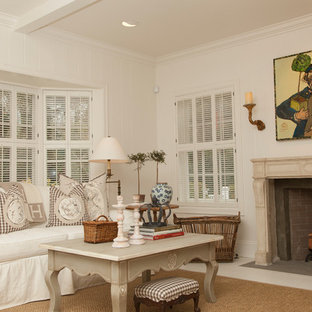 Inspiration for a timeless living room remodel in Portland with white walls