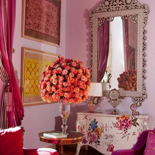Inspiration for a large eclectic formal open concept living room in Los Angeles with pink walls, light hardwood floors, no fireplace, no tv and beige floor.