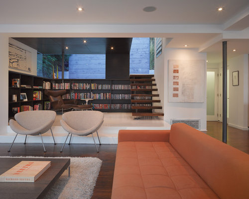 Small Minimalist Open Concept Dark Wood Floor Living Room Photo In Los Angeles With A Library