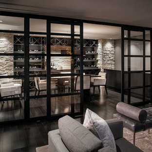 This is an example of a medium sized modern enclosed living room in San Diego with a home bar, white walls, painted wood flooring, a standard fireplace, a metal fireplace surround and a wall mounted tv.