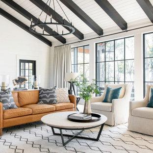 チャールストンの広いカントリー風おしゃれなLDK (白い壁、淡色無垢フローリング、茶色い床、三角天井、塗装板張りの壁) の写真