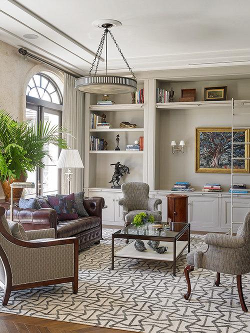 Tropical Medium Tone Wood Floor Living Room Library Idea In Miami With Gray  Walls