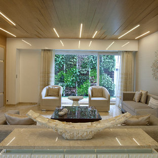 Example of a large trendy living room design in Mumbai with beige walls