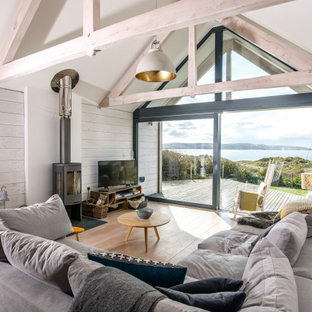 Photo of a nautical living room in Cornwall with a vaulted ceiling and tongue and groove walls.
