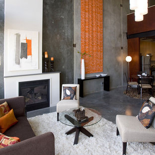 Example of a mid-sized urban formal and enclosed concrete floor and gray floor living room design in Portland with gray walls, a standard fireplace, no tv and a metal fireplace