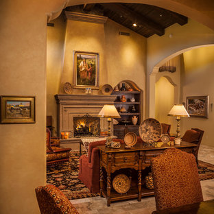 Example of a large tuscan formal and enclosed travertine floor living room design in Phoenix with beige walls, a standard fireplace and a stone fireplace