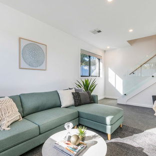 This is an example of a beach style living room in Canberra - Queanbeyan.