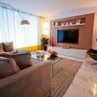 Example of a large trendy open concept marble floor and white floor living room design in Miami with white walls, no fireplace and a wall-mounted tv