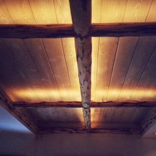 Hallway ceiling with LED edge-glow lighting behind cut log trims