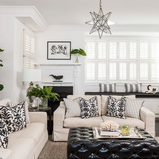 Traditional enclosed living room in Brisbane with white walls, dark hardwood floors, a standard fireplace, a plaster fireplace surround and black floor.