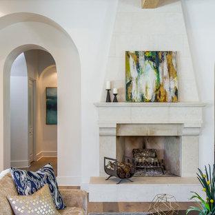 Ejemplo de salón para visitas cerrado, contemporáneo, grande, sin televisor, con paredes blancas, suelo de madera clara, chimenea tradicional y marco de chimenea de baldosas y/o azulejos