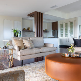 Photo of a mid-sized contemporary formal open concept living room in Brisbane with medium hardwood floors, brown floor and beige walls.