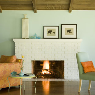 Photo of a rustic living room in San Francisco with blue walls and a standard fireplace.