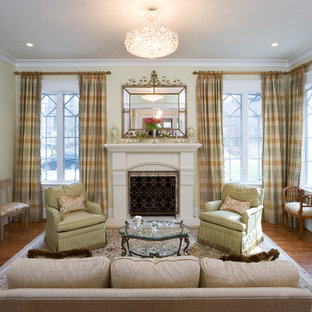 Example of a classic formal and enclosed living room design in DC Metro with a standard fireplace and no tv