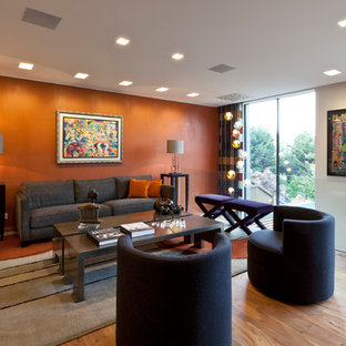 This is an example of a medium sized contemporary formal living room in London with orange walls, light hardwood flooring and beige floors.