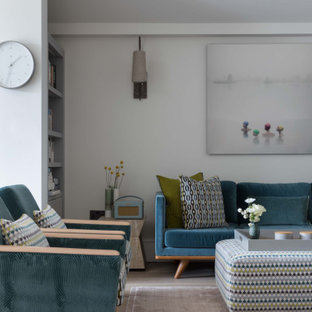 Inspiration for a medium sized contemporary formal open plan living room in London with white walls and beige floors.