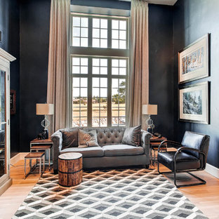 Contemporary formal enclosed living room in Denver with black walls, light hardwood flooring and no tv.