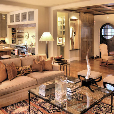 Example of a classic open concept living room design in Chicago with beige walls
