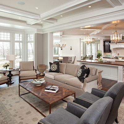 Example of a classic open concept brown floor and coffered ceiling living room design in Minneapolis with gray walls