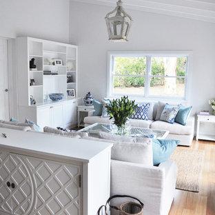 Elegant light wood floor living room photo in Brisbane with white walls