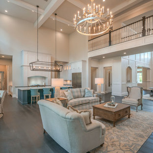 Living room - large coastal formal and open concept dark wood floor and brown floor living room idea in Houston with white walls, a standard fireplace, a tile fireplace and a wall-mounted tv