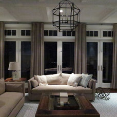 Contemporary Living Room by SJM DESIGN GROUP( subsidiary of) THE IRON CURTAIN