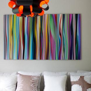 Esempio di un soggiorno minimal di medie dimensioni e stile loft con sala formale e pareti grigie