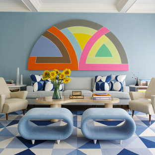 Inspiration for a mid-century modern living room remodel in New York with blue walls