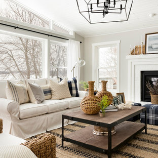 Living room - farmhouse open concept living room idea in Minneapolis with beige walls and a standard fireplace
