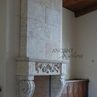 ニューヨークの広い地中海スタイルのおしゃれなLDK (フォーマル、ベージュの壁、標準型暖炉、石材の暖炉まわり、テレビなし) の写真
