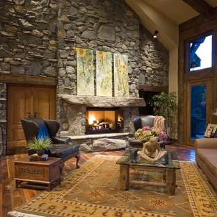 Example of a large classic formal and open concept carpeted living room design in Denver with beige walls, a standard fireplace and a stone fireplace