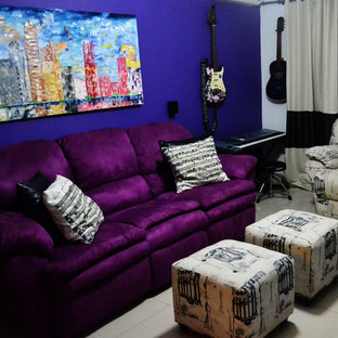 Example of a trendy living room design with a music area, purple walls and a wall-mounted tv