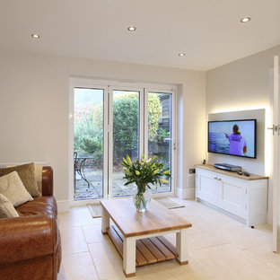 Large elegant open concept limestone floor living room photo in Hampshire with white walls, no fireplace and a media wall