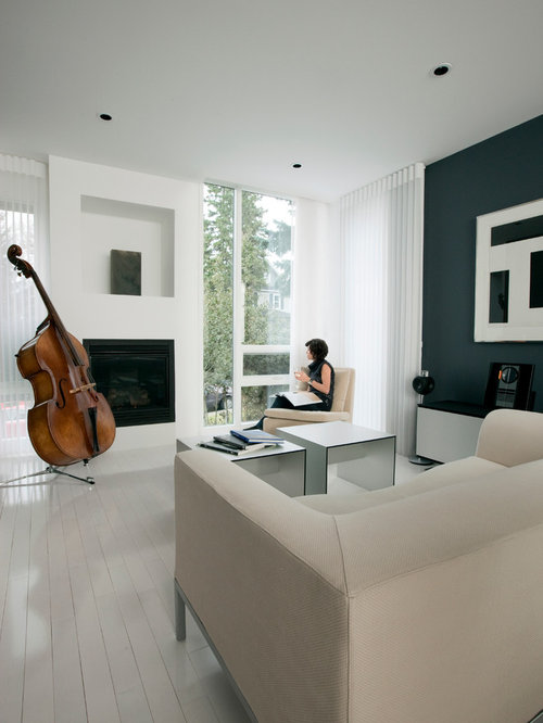 inspiration for a contemporary painted wood floor and white floor living room remodel in calgary - White Wood Floors Living Room