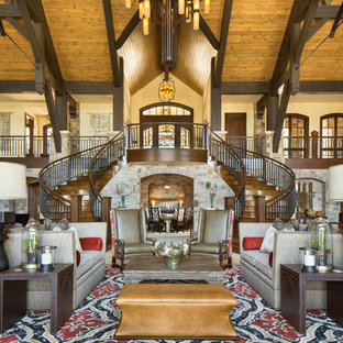 Design ideas for an expansive rustic formal open plan living room in Denver with white walls, no fireplace and no tv.