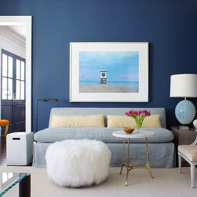 Inspiration for a large contemporary formal carpeted living room remodel in New York with blue walls, a standard fireplace, a stone fireplace and no tv
