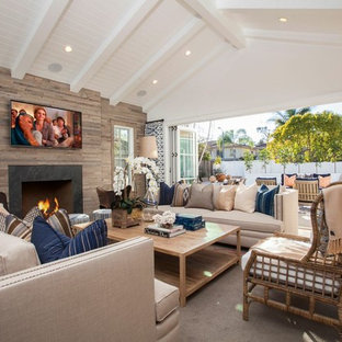 Living room - eclectic light wood floor living room idea in Orange County with white walls and a wall-mounted tv