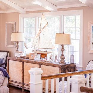 Ispirazione per un soggiorno design di medie dimensioni e aperto con pareti beige, pavimento in legno massello medio, camino classico, cornice del camino in legno, TV nascosta e pavimento marrone
